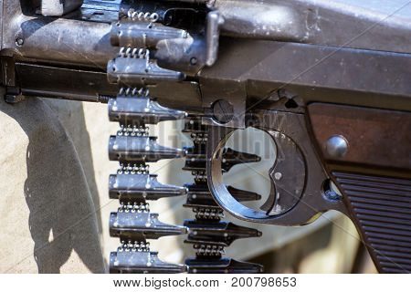 Machine gun fragment and empty cartridge belt