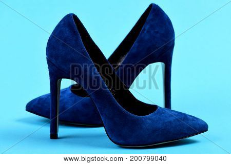 Elegant Blue Shoes On Blue Background As Shopping Concept