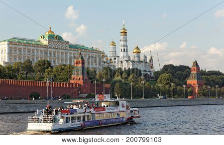 MOSCOW, RUSSIA - JUNE 22, 2017:Tourist boats floats on the Moskva River in the background with  the Moscow Kremlin, Russia. The most important sight in Moscow