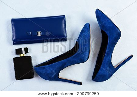 Female Shoes, Perfume And Clutch Isolated On Blue Background