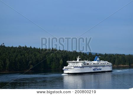ACTIVE PASS, BC, CANADA. AUGUST 14, 2017. The Spirit of Vancouver Island sails through Active Pass between Victoria and Vancouver Island.