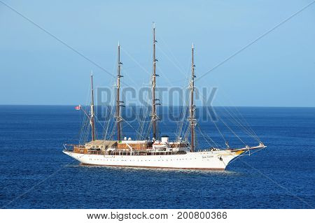 Cozumel Mexico-March 12 2016 : Yacht or sailing tail cruise ship in sea or ocean water in Cozumel Mexico on blue sky background. Travel and travelling concept