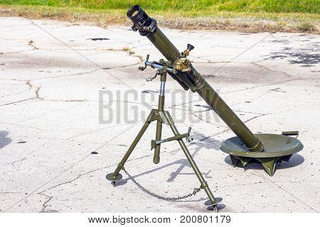 Mortar cannon gun is on the asphalt