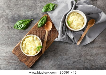 Composition with mashed potatoes in ramekins on wooden background