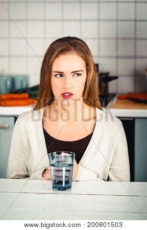 Beautiful caucasian woman sitting in the kitchen