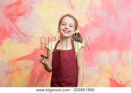 Baby Cook In Red Chef Apron On Colorful Abstract Wall