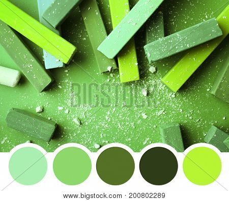 Colorful chalks, closeup. Palette with green color