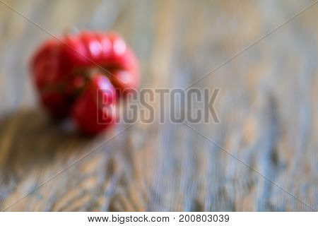 Awesome Abstract Blur Tomato Like A Human Head On Wooden Background With Copy Space For Web Design,