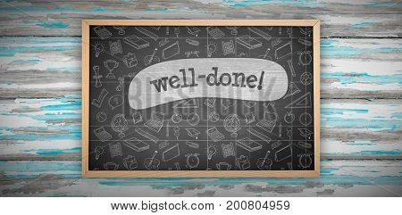 Chalkboard against well-done! against black background