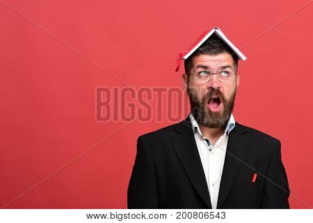Businessman With Shocked Face And Glasses On Light Red Background