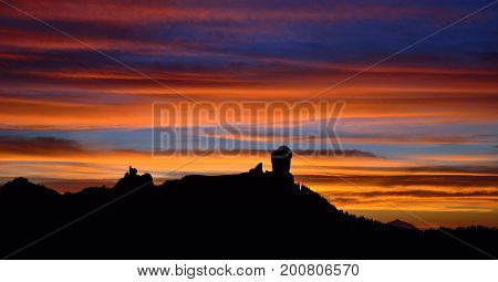 Vibrant sunset with cloudy sky of intense colors, Roque Nublo, Gran canaria, Canary islands