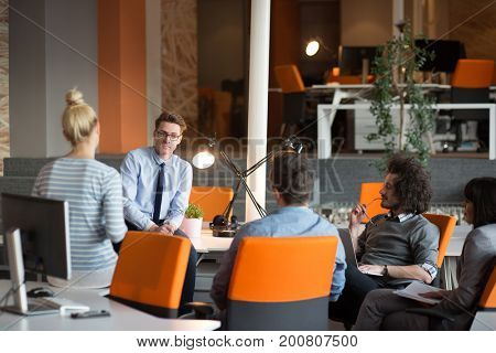 Group of a young business people discussing business plan  in the office