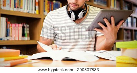 Student studying in library with tablet at university