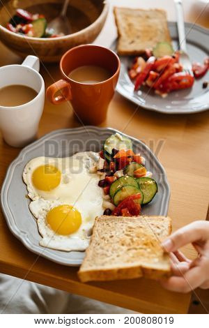 In the morning Breakfast is two eggs toast salad and coffee.