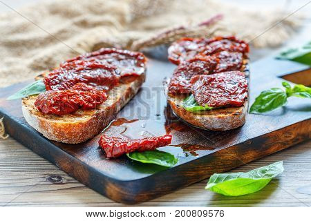 Sun-dried Tomatoes On Slices Of Homemade Bread.