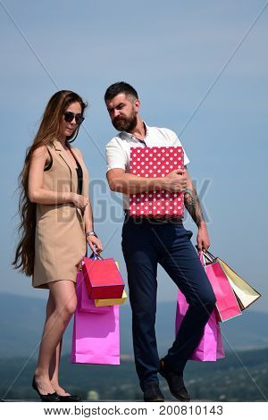 Shopping And Relationship Concept. Sexy Girl And Guy
