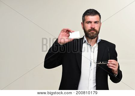 Guy With Satisfied Face And Glasses Isolated On Light Grey