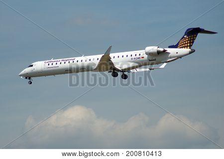 FRANKFURT, GERMANY - JUL 09th, 2017: Lufthansa CityLine Lufthansa Regional Canadair CRJ-900LR with identification D-ACNE approaching at Frankfurt International Airport Germany, FRA .
