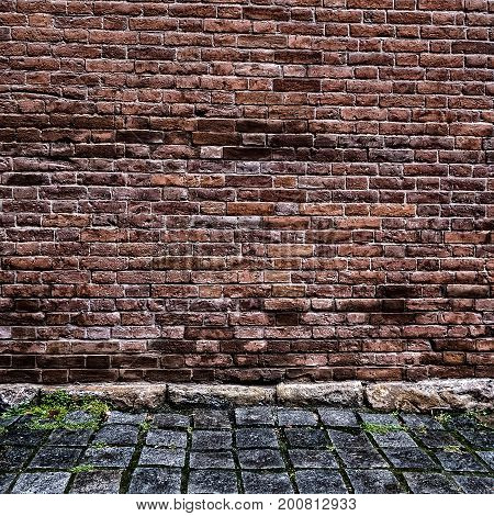 Toned Photo of Old Brick Wall with Cobblestone Road
