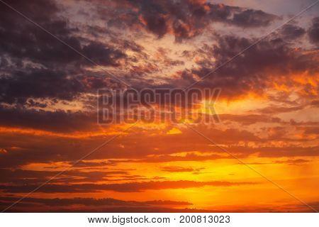 Fiery orange and red dramatic sunset sky. Beautiful background