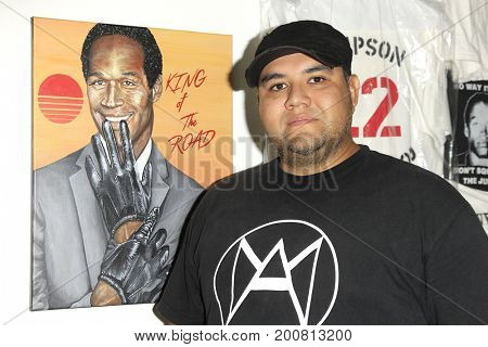 LOS ANGELES - AUG 17: Ricardo Cisneros at the OJ Simpson pop-up museum at the Coagula Curatorial Gallery on August 17, 2017 in Los Angeles, California