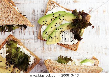 Sandwich With Avocado And Sesame - Healthy Breakfast Concept