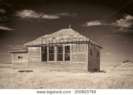 abandoned old house in Nebraska Sandhills, sepia toned image