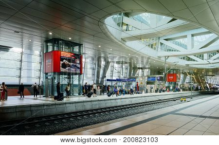 FRANKFURT GERMANY - AUG 8 2017: Frankfurt Airport Train station Air Rail terminal with people commuting on the platform waiting for the ICE fast train. Fraport Train station is on of the bussiest train station in Germany