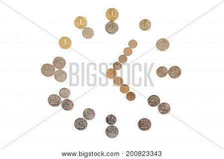 Coins formed into clockwork.