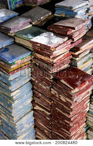 Pile of colored handcrafted tiles in Fez Morocco