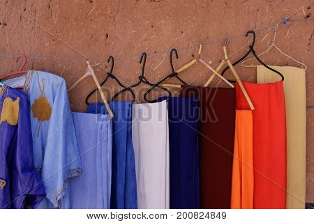 Handcrafted dresses hanged in Ait Benhaddou Morocco