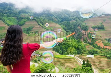 Girl Making Soap Bubbles At Rice Terrace Viewpoint
