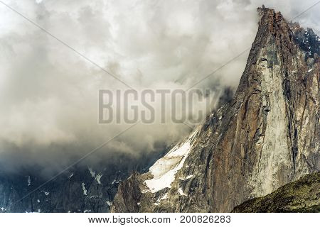 Chamonix Mt Blanc Massif and Aiguille du Midi Covered by Clouds. French Alps.
