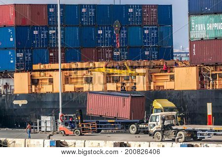 Labuan,Malaysia-Aug 2,2017:Shipping containers unloading of containers on a container truck at Labuan port,Malaysia on 2nd Aug 2017.