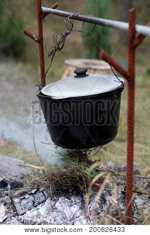 Cooking at the stake in the cauldron. Tourism. Meals in the open air.