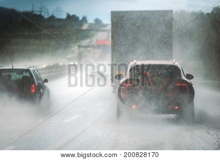 Heavy Rain Highway Traffic. Extreme Road Conditions. Rainy Weather Driving.