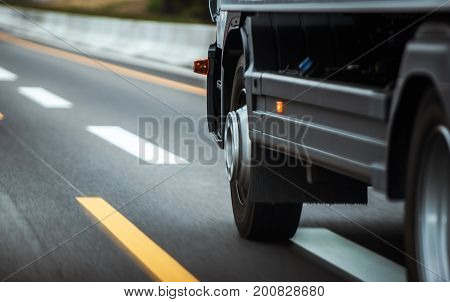 Truck on a Highway. Heavy Duty Wheels Closeup. Heavy Transportation Photo Concept.