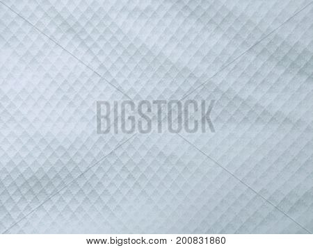 Light gray fabric as a background close-up
