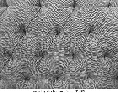 Chesterfield style checkered soft tufted fabric furniture diamond pattern decoration with buttons close up