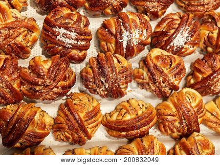 food, cooking and baking concept - buns or pies at bakery