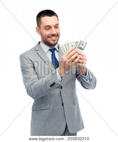 business, people and finances concept - smiling businessman counting american dollar money