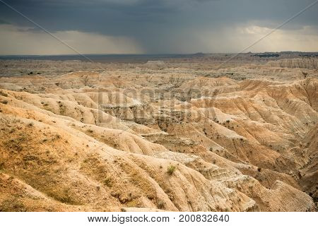 Rain dropping on the dry eroded landscape in the Badlands
