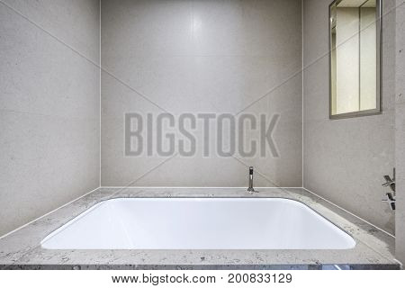 beautiful large built in bath with shellstone tiles