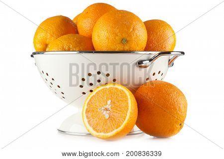 Fresh oranges in a colander