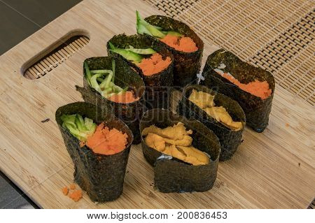 Home Made Sushi Sitting On Cutting Board