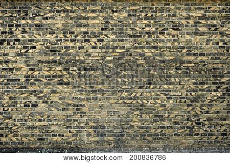 old brick wall for texture or background, yellow and black color