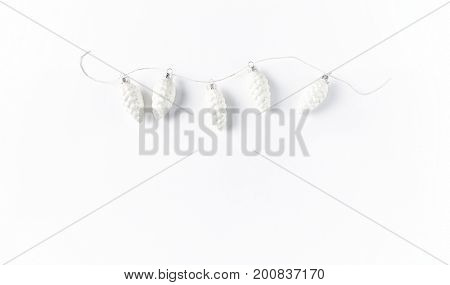 White Cone-shaped Christmas Ornaments on a String