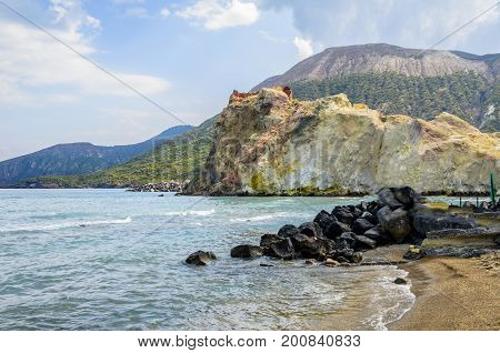 Beach of the island of vulcano with its volcanic rocks and rock formations of colored by the minerals