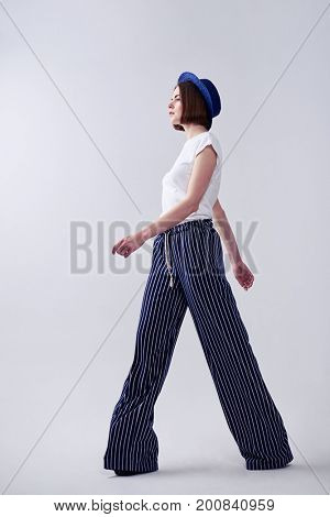 Full-length of magnificent female walking while posing in studio with copy space
