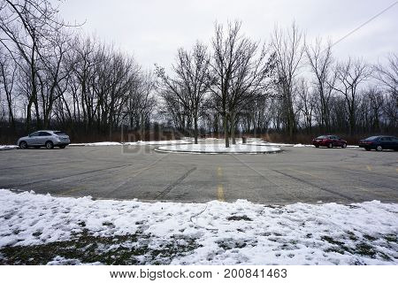 JOLIET, ILLINOIS / UNITED STATES - JANUARY 3, 2016:  Cars are parked in the parking lot at the Black Road Access to the Rock Run Preserve.